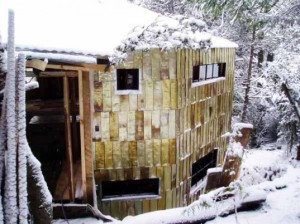 house clad in used tomato can tiles in Patagonia's dense wilderness.